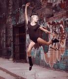 Beauty teenager girl dance on street stock image