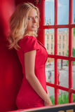 Beauty in telephone booth. Stock Photo