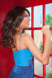 Beauty in telephone booth. Stock Image