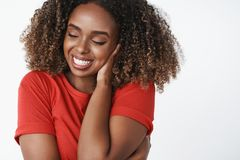 Beauty, tenderness and sensuality concept. Indoor shot of carefree relaxed and happy young healthy african-american girl royalty free stock images