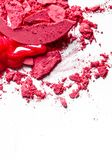 Crushed eyeshadows, lipstick and powder isolated on white background. Beauty texture, cosmetic product and art of make-up concept - Crushed eyeshadows, lipstick royalty free stock image