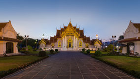 Beauty of Thai temple call Wat Ben or Marble Temple during twiligh Stock Photo