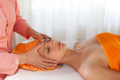 Beauty Therapist Giving Massage Royalty Free Stock Photos