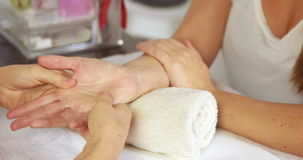 Beauty therapist massaging customers hand stock video