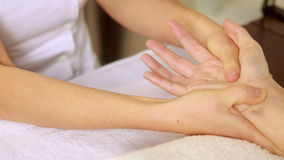 Beauty therapist massaging customers hands stock footage