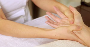 Beauty therapist massaging customers hands stock video footage