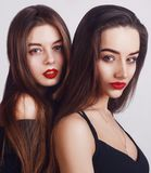 Beauty too womans face Portrait. Brunette female looking at camera. Youth and make-up Concept.  on a white background. Long hair and red lips, pretty face Royalty Free Stock Photos
