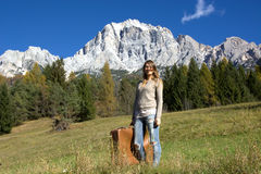 The woman traveling to the mountains, precisely in the Belluno Dolomites, towards Cortina D`ampezzo. The beauty of traveling by any means, trains, buses, metro Royalty Free Stock Photo