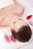 Beauty treatment. Beautiful caucasian woman lying in a spa center relaxing Royalty Free Stock Photo