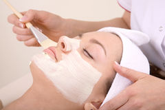 Beauty treatment. A woman receives facial therapy at the spa Stock Photography