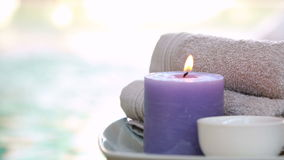 Beauty treatment in bowl presented on plate with candle Stock Photo