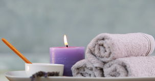 Beauty treatment in bowl presented on plate with candle Stock Photography