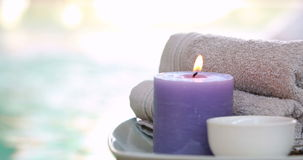 Beauty treatment in bowl presented on plate with candle Royalty Free Stock Photos