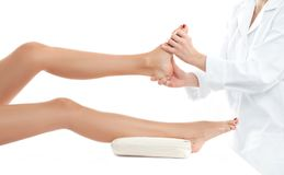 Beautiful woman having massage leg at spa salon. Beauty treatment concept. Beautiful woman having massage leg at spa salon Stock Photography