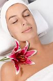 Beauty treatment in dayspa. Young woman laying eyes closed in dayspa, getting facial treatment, relaxing Royalty Free Stock Photography