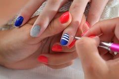 Beauty treatment of fingernails Stock Photo