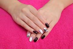 Beauty treatment of fingernails, hands on towel Stock Photo