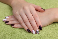 Beauty treatment of fingernails, hands on towel Royalty Free Stock Photography