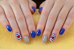 Beauty treatment of fingernails, manicure. Finger nail treatment ,hands with painted fingernails Stock Photography