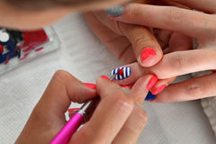 Beauty treatment of fingernails, manicure Stock Images