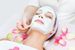 Beauty treatment with cosmetician. Beauty treatment in salon with cosmetician stock image