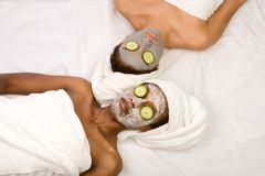 Beauty treatment spa. Two girls are relaxing during facial mask application in spa Royalty Free Stock Image
