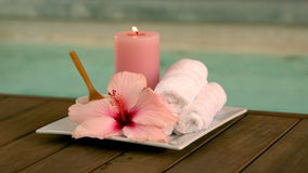 Beauty treatments and candle poolside with lily stock video