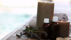 Beauty treatments presented with dried lavender and candles stock footage