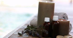 Beauty treatments presented with dried lavender and candles stock video footage