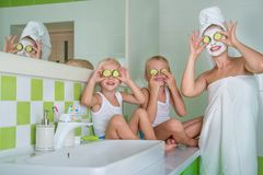Mother and children make a face mask in the morning.Beauty treatments for the skin. Beauty treatments for the skin.Mother and children make a face mask in the royalty free stock photos