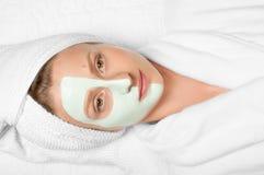 Beauty Treatments. Woman applying facial mask at spa Royalty Free Stock Photography