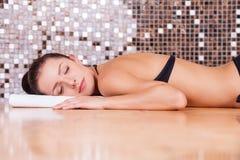 Beauty in Turkish bath. Beautiful young woman relaxing in Turkish bath Royalty Free Stock Image