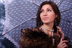 Beauty with a umbrella Stock Photos