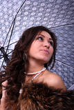 Beauty with a umbrella. Portrait of the beautiful young woman with a umbrella Stock Photo
