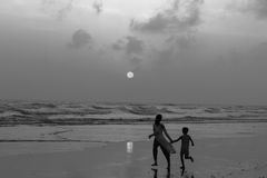 Beauty of unknown flower. This boy and girl are siblings. They were in the longest sea beach in the world that is coxsbazar. They could not dominate their mind stock images