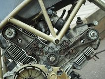 Beauty of v-twin. Belt driven gas distribution mechanism on air cooled v-twin shaped motorcycle engine stock images