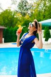 Beauty and vacation. Pretty young woman near swimming pool stock photography