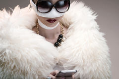 Beauty victim. Portrait of diva after rhinoplasty reading text message Royalty Free Stock Image