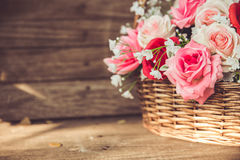 Beauty vintage flower rose in the basket. Royalty Free Stock Images