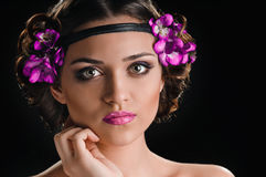 Beauty and violets Stock Photos