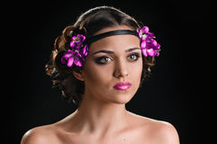 Beauty and violets Stock Images