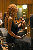 Beauty violinist  during a concert Royalty Free Stock Photography