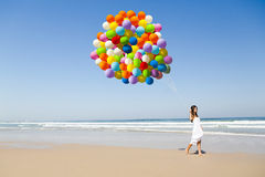 Beauty walking with ballons Stock Photos