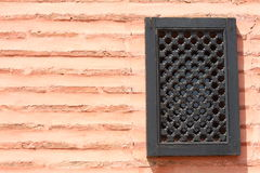Beauty  wall with window. Black window make in Morocco, Africa Stock Images