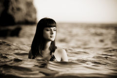 Beauty in water. Young beautiful woman into the water Stock Photography