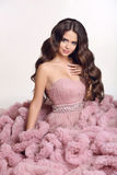 Beauty wavy hair. Fashion brunette woman in gorgeous long pink d Stock Photos