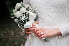 Beauty wedding bouquet of rose flowers and eucalyptus branches in bride`s hands stock photos