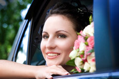 Beauty in the wedding car Royalty Free Stock Image