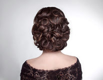Beauty wedding hairstyle. Bride. Brunette girl with curly hair s Stock Photography
