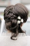 Beauty wedding hairstyle with flowers Stock Photo